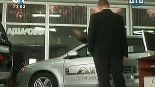 She is cleaning a car while showing her ass and panties