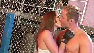 A fit girl is getting fucked in the arena by a large dude