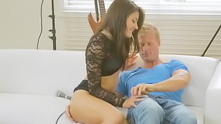 Brunette with a sexy ass moves her hands on her partner's cock