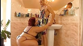 Redhead slut with obese tits with her white lover