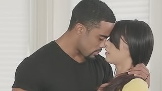 A black dude is getting a blow job from a sexy little bitch